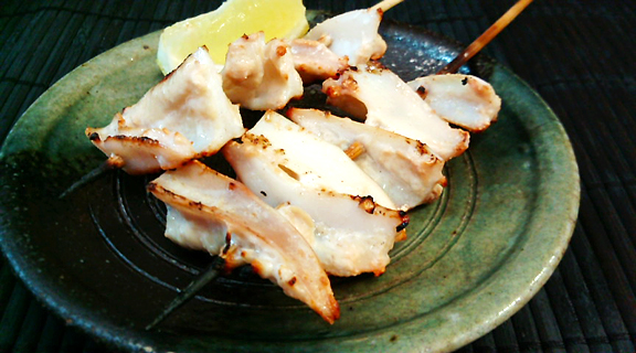 "Couple of the Cartilage ""Kushi"" on Small Dish with a piece of Lemon"