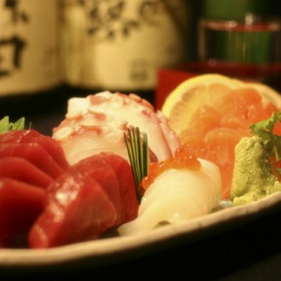 Sashimi of Octopus, Squid, Tuna and Salmon on the dish.